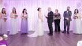 This image shows the wedding vows taking place in front of translucent drapery which we hung and backlit with uplighting in the bridal colours. Photo by David Marasigan Photography.