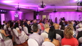 This image shows how the wedding ceremony and the reception that was held in a multi-purpose meeting room used our lighting services to enhance the décor. Photo by Artistic Illumination.