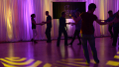 Slowly moving floor patterns combined with soft shades in the backlighting combine to create a relaxing intimate environment for social dancing. Photo by Memories in Motion.