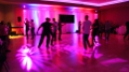 This image shows using moving heads up high with the right gobos creates dynamic imagery on the dance floor creating a festive party atmosphere.